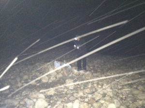 Cold fisherman braving snowfall while night fishing. (Not recommended)